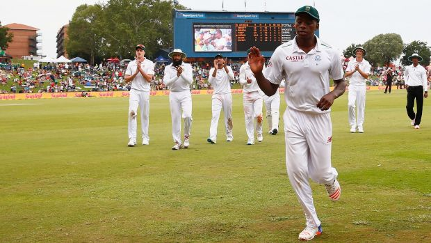 Kagiso Rabada leads South Africa off the pitch at the end of England's first innings.