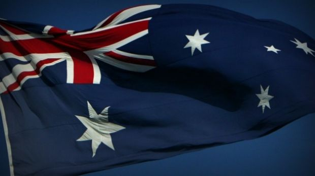 A man was charged after allegedly setting a flag on fire in Cairns.