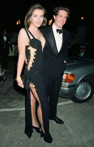 Hurley and Grant dated for 13 years in the 1990s, even stepping out together when she wore that famous Versace safety ...