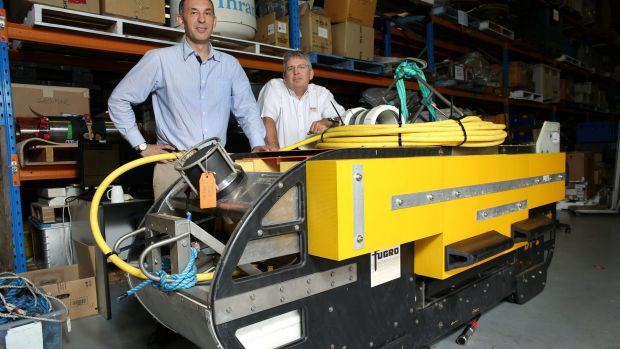 The 'fish' sonar device used in the search for MH370. Posing with the 'fish' are Fugro operations manager Paul Kennedy ...