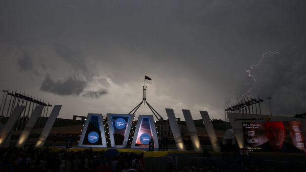 A storm passes over Australian of the Year ceremony.