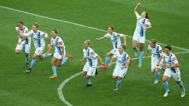 Joy and relief: Melbourne City celebrate their penalty shootout victory over Brisbane Roar.
