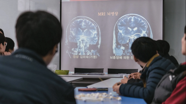 Participants watch a documentary on the impact of stress on the brain.
