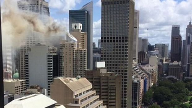 Smoke billows from the top of a Sydney building.