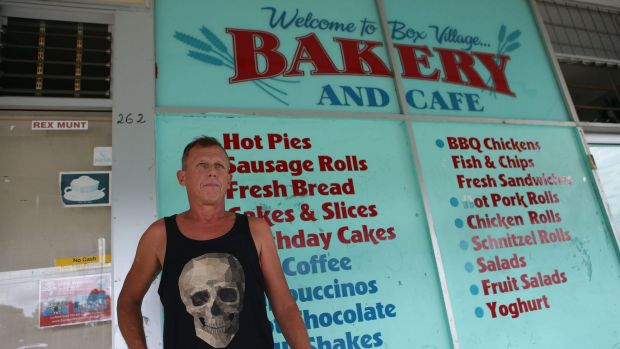 Ross Paull, standing outside the Box Village Bakery and Cafe, said his family also became ill.