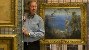 Geoffrey Edwards with Arthur Streeton's Ocean Blue, Lorne.