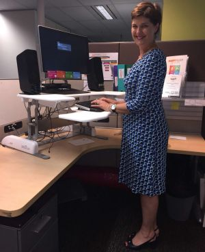 Anna-Louise Bouvier and her sit/stand desk.