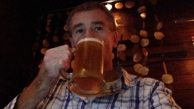 Tony Ozanne drinks a beer on Australia Day at a clandestine bar for non-Muslims in Lahore, Pakistan.