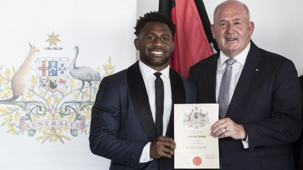 New Aussie: James Segeyaro with Governor General Peter Cosgrove at the Australia Day ceremony on Tuesday.
