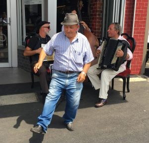 Local man Rocky Paoletti, 78, dances to a band outside Mr Piccolo cafe in Macaulay Road, Kensington.