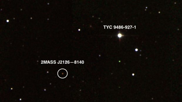 A photograph captures the planet 2MASS J2126-8140, in orbit around its host star TYC 9486-927-1.