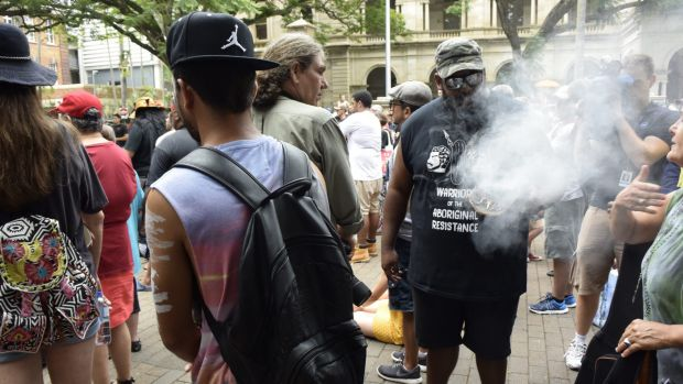 Hundreds of Aboriginal activists rally at Queensland's Parliament House.