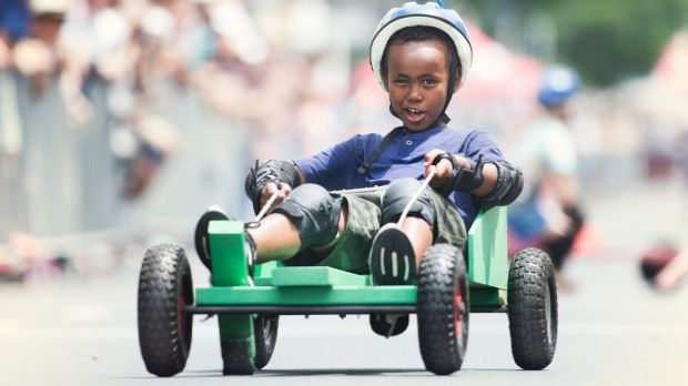 Imran Saney, 8, competing in the 2016 Kensington Australia Day Festival's children's billycart races down Macaulay Road.