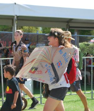 Protesters marching through the City Of Perth's Survival Day concert.