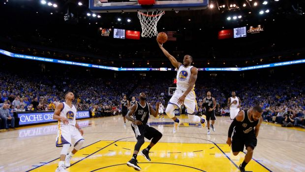 Lopsided: Andre Iguodala goes up for a shot against Jonathon Simmons and Patty Mills at ORACLE Arena.