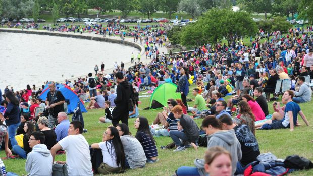 People gather for the Australia Day fireworks on the shores of Lake Burley Griffin. Canberra's population was hovering ...