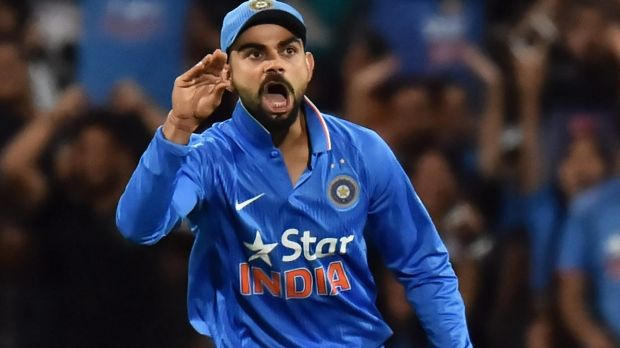 Stop talking ... Virat Kohli of India reacts after taking a catch to dismiss Steven Smith, who was commentating as he played.