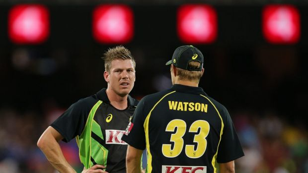 Australia's James Faulkner left and Shane Watson talk during their T20 International cricket match against India in Adelaide.