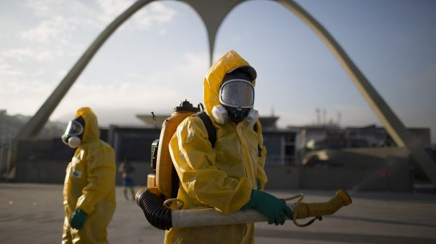 A health worker stands in the Sambadrome as he sprays insecticide to combat mosquitoes that transmit the Zika virus in ...