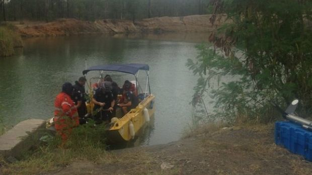 Search crews scour the quarry for the body of 16-year-old Goodna boy Duncan Wilmott.