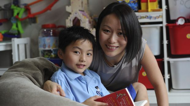 Jovern Loh, 5, pictured with his mother Li San Loh, will start kinder with the same speech and language skills as his ...