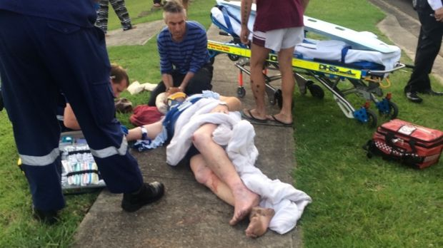 Paramedics attend to Michael Kimmorley after he was hit by a four-wheel-drive.