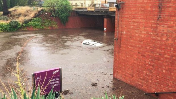 This car was underwater at Geelong train station after it was hit with heavy rain on Wednesday.