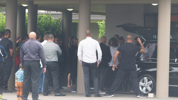Relatives and friends perform the haka outside David Petersen's funeral on Wednesday.