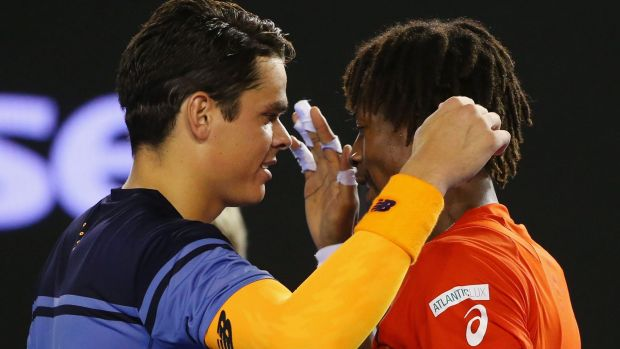 Respect:  Gael Monfils congratulates Milos Raonic after his quarter-final victory.