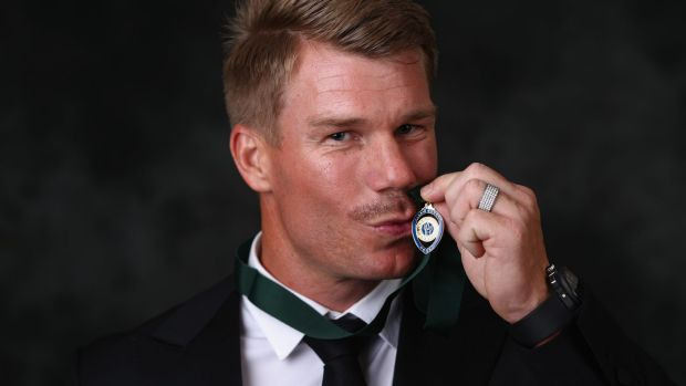 Sealed with a kiss:  David Warner poses after winning the Allan Border medal.