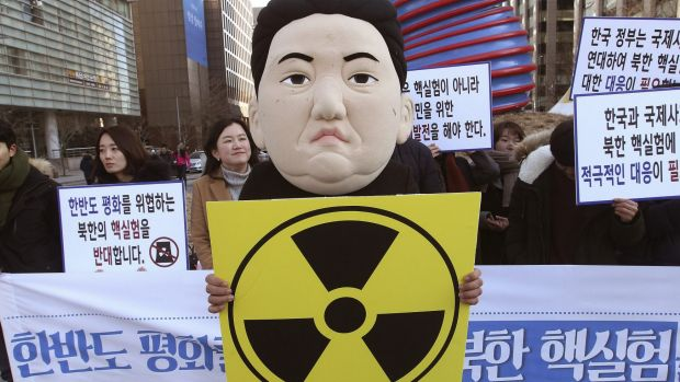 A South Korean university student wearing a mask depicting North Korean leader Kim Jong-un.