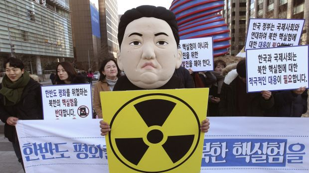 A South Korean university student wears a mask depicting North Korean dictator Kim Jong-un, after the North Korean ...