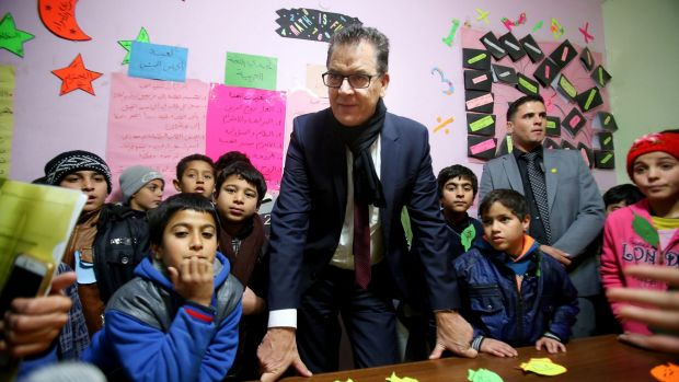 German Minister for Economic Co-operation and Development Gerd Mueller with Syrian refugee children during his visit to ...