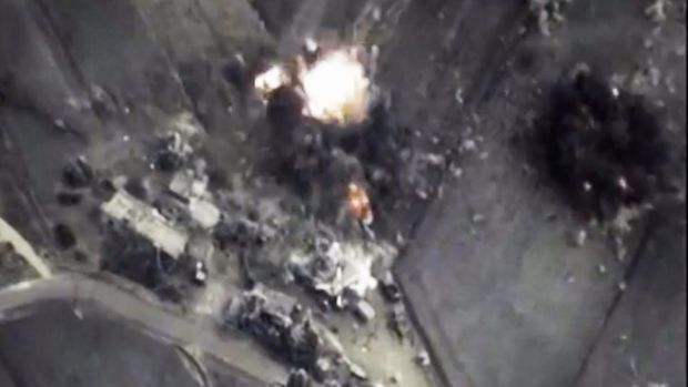 An explosion seen in an October video released by the Russian Defence Ministry purporting to be from air strikes in Syria.