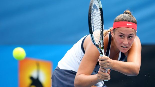Sara Tomic plays a backhand in her junior quarter-finals match against Baijing Lin.