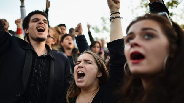 People sing the French national anthem at Place de la Republique two days after the November 13 attacks.