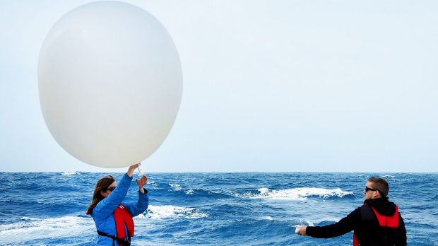 Deploying weather balloons from RV Investigator.