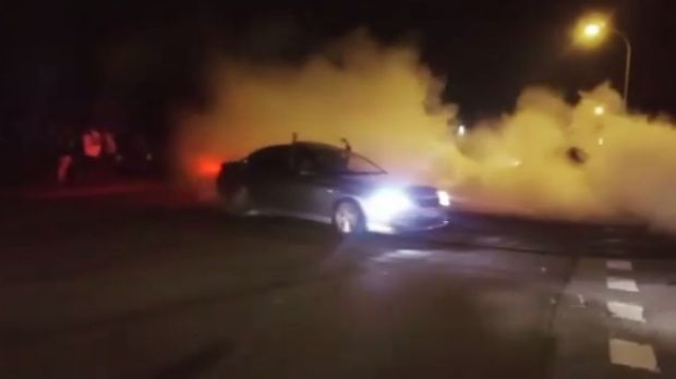 A Ford does burnouts in footage of the meeting posted on Instagram.