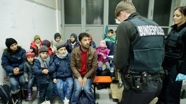 German police register migrants and refugees arriving from Austria in Passau, Germany.