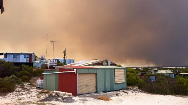 The fire from a beach shack at Wedge Island about 15 kilometres south.