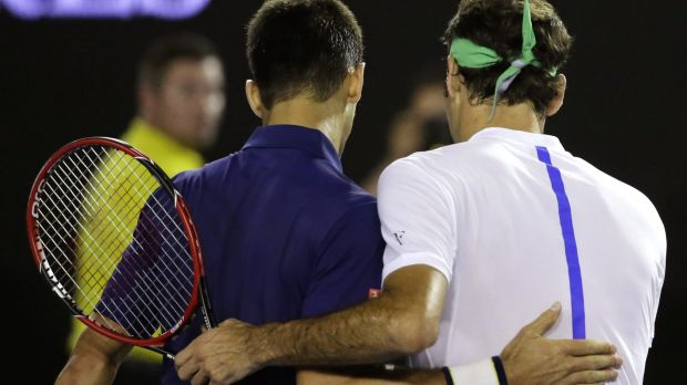 I'll be back: Federer congratulates Djokovic after their semi-final.