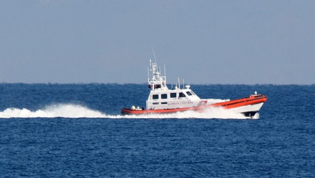 An Italian vessel from the European border agency Frontex assists the Greek Coast Guard in the search for survivors ...