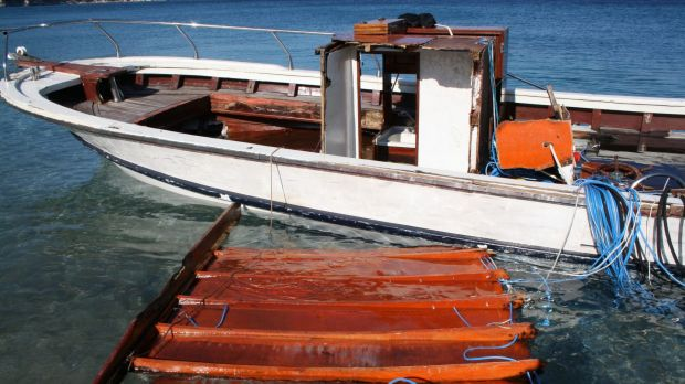 A vessel used by refugees is seen docked at the village of Kokkari on the eastern Greek island of Samos.
