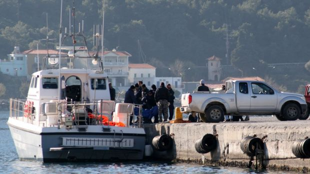 Coast guard vessel arrives with the dead bodies of refugees at the port of Vathi on the Greek island of Samos on ...