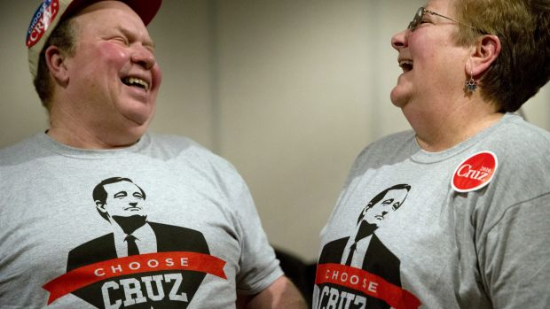 Denny Swaim, left, and wife Sandi share a laugh at a campaign event in Ottumwa, Iowa.