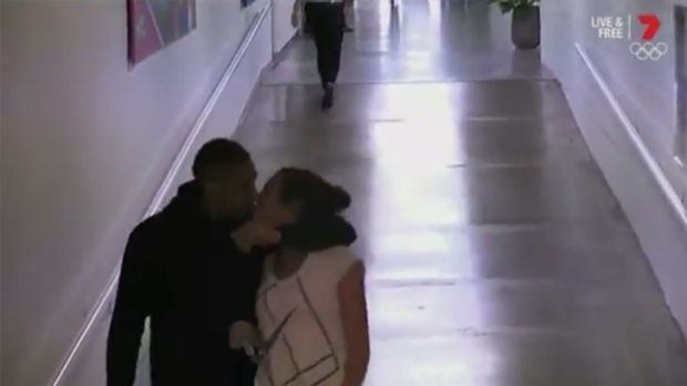 Nick Kyrgios and Ajla Tomljanovic kiss in the corridor behind Rod Laver Arena.