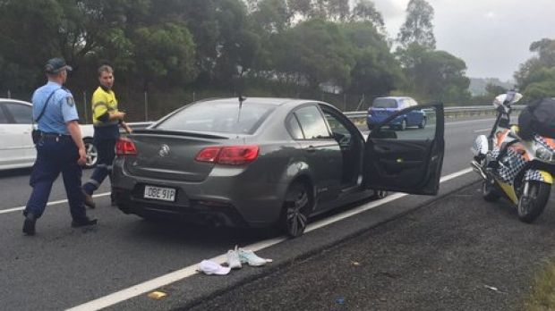The allegedly stolen car travelled into Queensland on just its wheel rims after road spikes wee laid, police said.