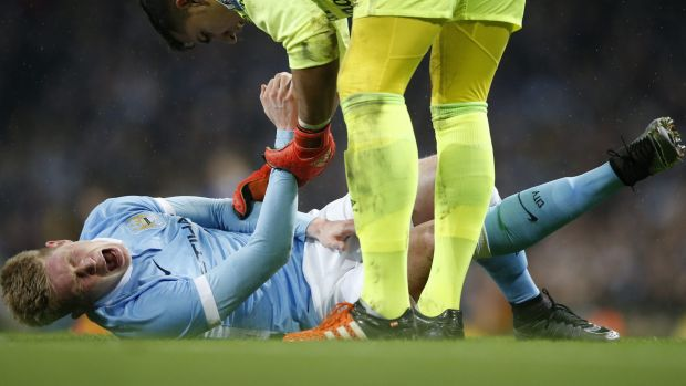 Massive blow: Manchester City's Kevin De Bruyne feels the pain.