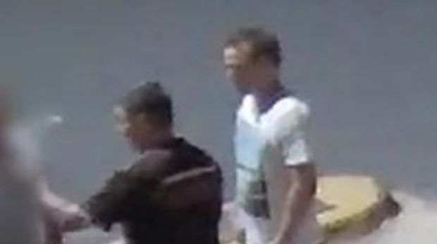 CCTV footage shows the man in the white shirt seconds before he punched the man in the dark shirt to the ground.