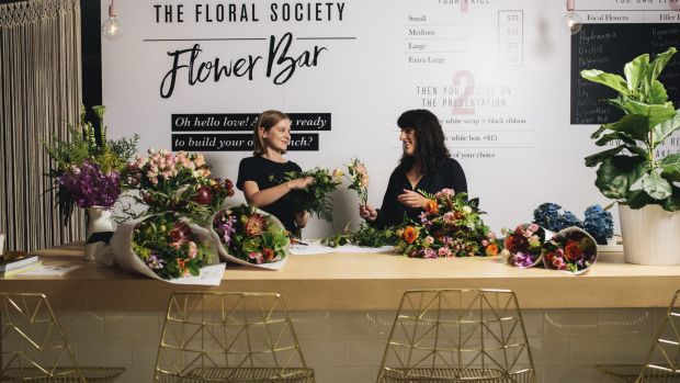 Customers are invited to take a seat at the Flower Bar and watch their floral creations be assembled in front of them.
